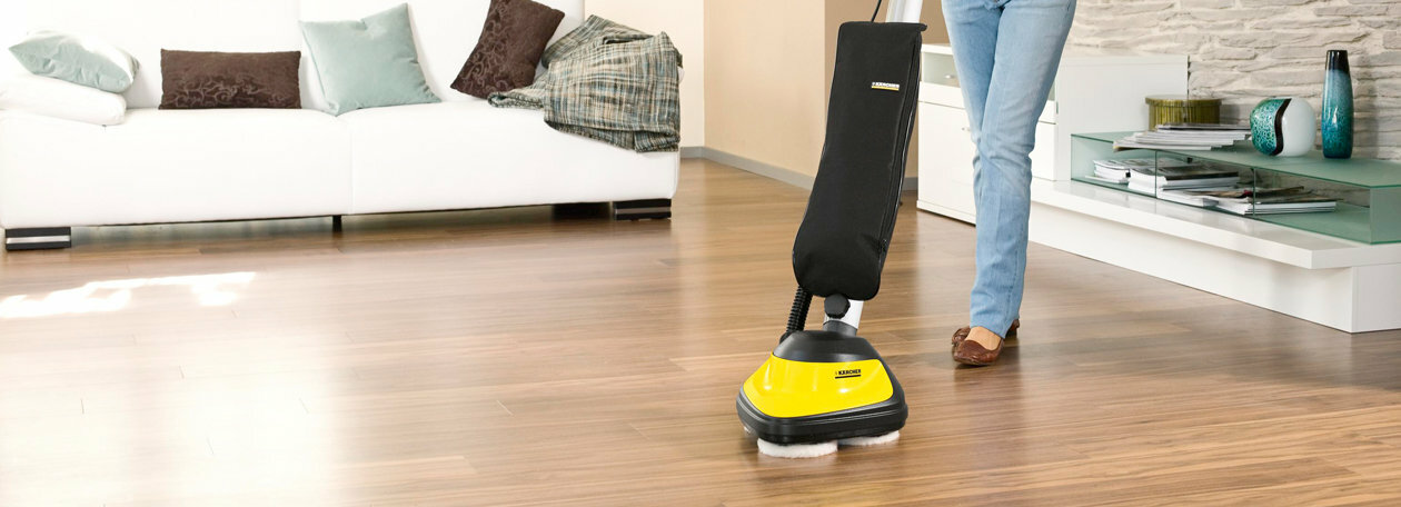 Polishing floors to a high gloss shine.